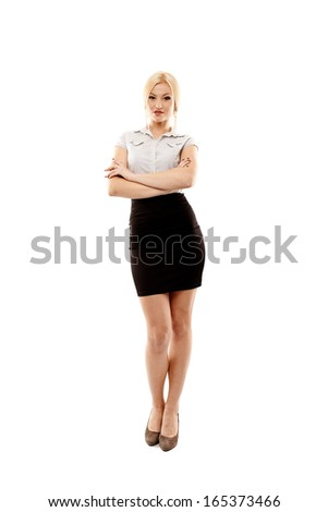 Full length studio portrait of young successful businesswoman with arms folded, isolated over white background