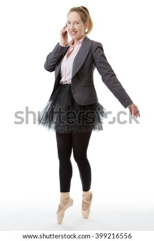 Full length studio shot of a business ballerina en pointe with a mobile phone  - stock photo