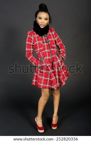 Full-Length Studio Shot of a Pretty African Fashion Model, Against a Grey Background - stock photo