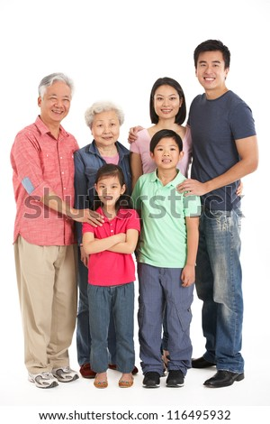Full Length Studio Shot Of Multi-Generation Chinese Family