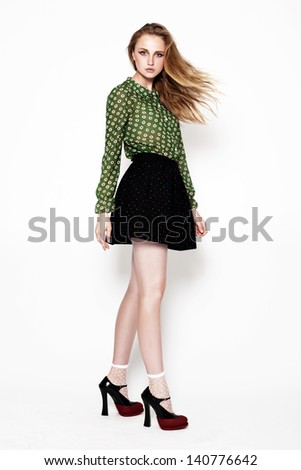Full length studio shot of pretty model  in motion - stock photo
