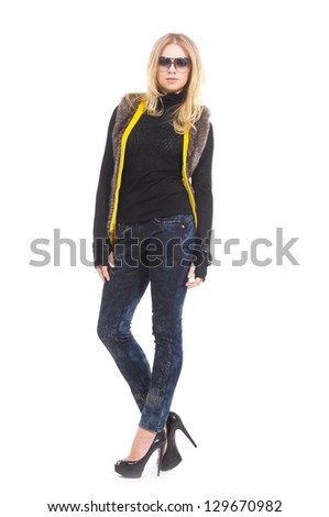 Full length The young girl in sunglasses posing in studio - stock photo