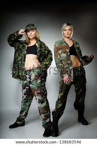 ... women in military clothes army girls on gray background. - stock photo