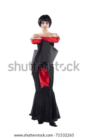 Full length view of a scary vampire woman with arms or wings crossed looking at the camera. Isolated on pure white background. - stock photo