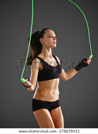 Full length view of an attractive woman with jumping rope. - stock photo