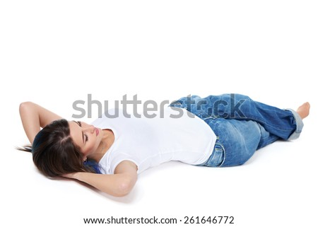 Full length woman lying down at floor on her back with hands over head, having rest, isolated on white background - stock photo
