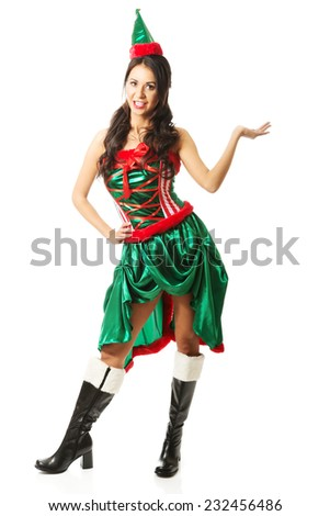 Full length woman wearing elf clothes, holding something invisible. - stock photo