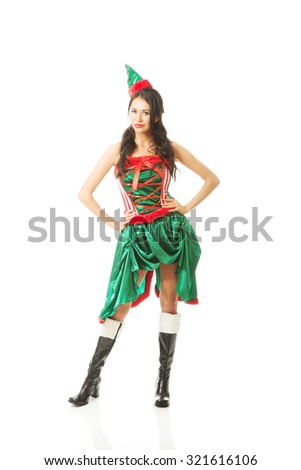 Full length woman wearing elf clothes, touching her hips. - stock photo