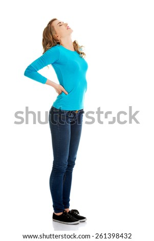 Full length woman with back pain. - stock photo