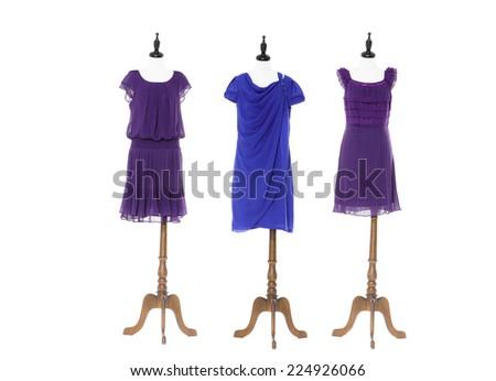full-length Women evening dress on three dummy - stock photo