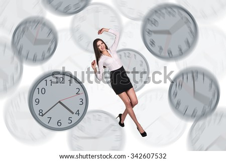 Full length young businesswoman floating among big clocks. Isolated on white background - stock photo