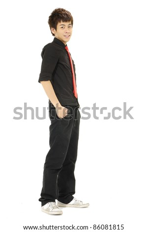 full-length young casual man standing with hands in pockets - stock photo