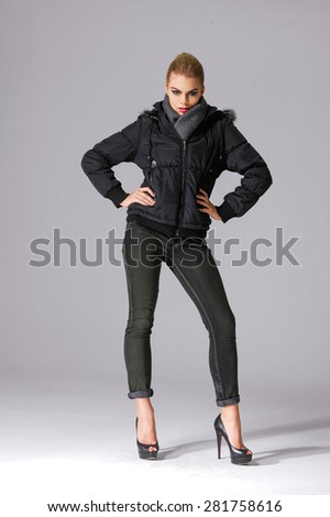 Full length young girl in jeans against white background - stock photo