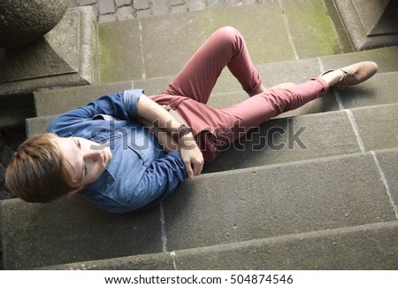 Full length young handsome man fashion model casual style posing on street of old town Gdansk Poland Europe