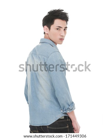 Full length Young man in jeans standing back on white background