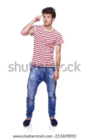 Full length young man looking skeptically to the blank copy space, isolated on white - stock photo