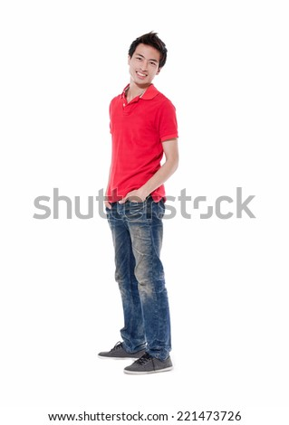 Full length young man standing in jeans posing with his hands on his pockets - stock photo