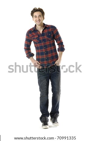 Full length young man standing with hands in pockets - stock photo