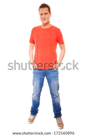 Full length young man wearing red t-shirt jeans casual fashion style with hands in pockets, isolated on white background