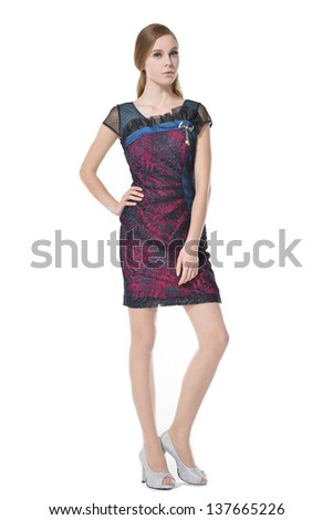 Full length young woman in elegant dress posing white background