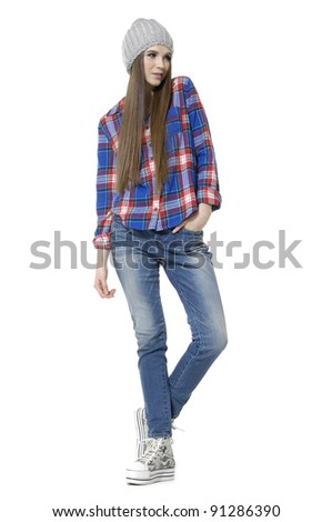 Full length young woman in jeans posing