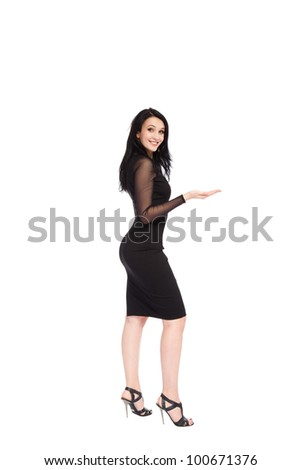 full length young woman standing happy smiling holding her hand showing something on the open palm with empty copy space, concept girl advertisement product, isolated over white background