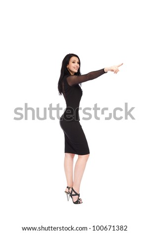 full length young woman standing happy smiling point finger showing something on the corner with empty copy space, concept girl advertisement product, isolated over white background - stock photo