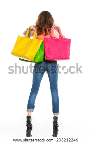 Full-length young woman with colorful bag back  - stock photo