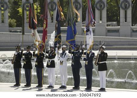 Full military ceremonial flags in front of National World War II Memorial, Washington, DC on May 8, 2007 in honor of visit of Her Majesty Queen Elizabeth II - stock photo