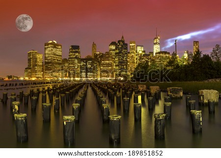 Full moon and New York City Manhattan panorama at night  - stock photo