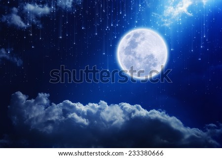 Full moon in night sky with falling stars and mysterious light from above. Elements of this image furnished by NASA  - stock photo