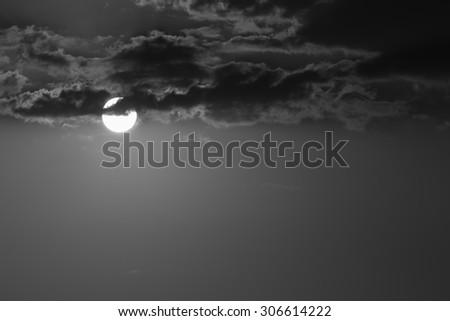 full moon in the dark night, black and white monochrome image - stock photo
