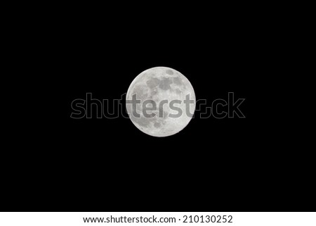 Full Moon isolated as Supermoon night with the closest approach the Moon makes to the Earth on its elliptical orbit, resulting in the largest apparent size of the lunar disk as seen from Earth. - stock photo
