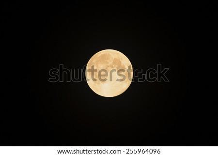 Full moon isolated on black background. - stock photo