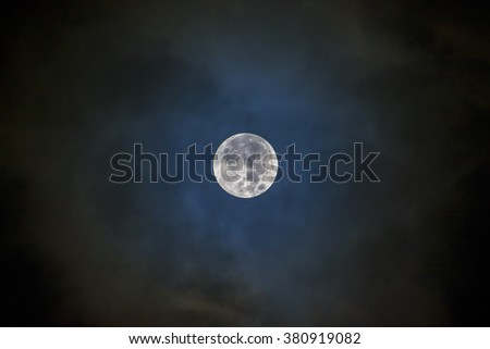 Full moon on the dark blue sky