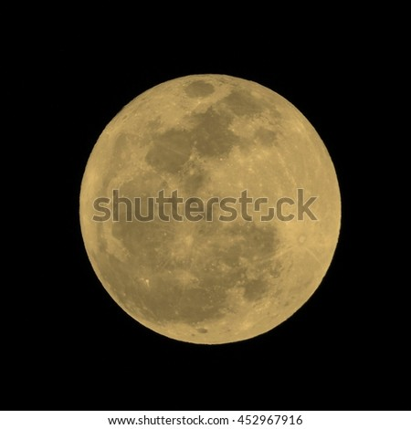 Full moon over dark black sky at night seen with a telescope from northern emisphere vintage sepia - stock photo