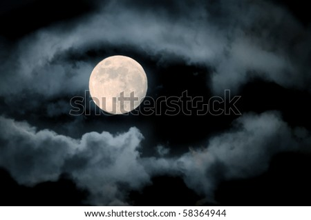 full moon over dark sky with.