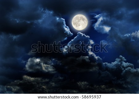 full moon over dark sky with. - stock photo