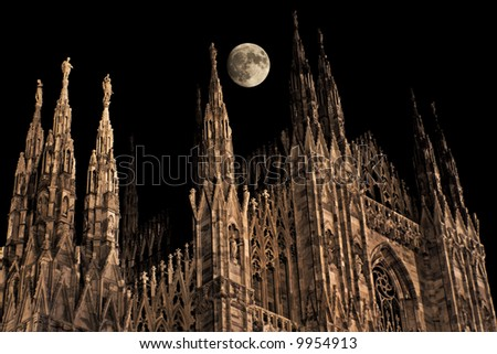 full moon over Milan cathedral pinnacles - stock photo