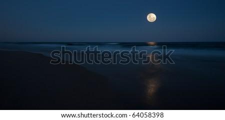 Full moon over ocean, Queensland Australia - stock photo