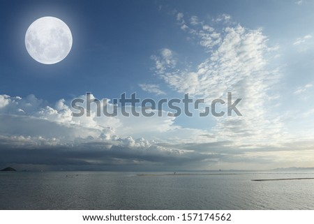 Full moon over tropical sea and white cloud - stock photo