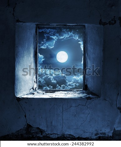 Full moon seen from a window - stock photo