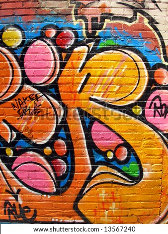 Full of color graffiti on brick - stock photo