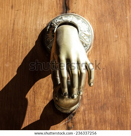 Full of mistery in this detail of ancient knocker. - stock photo
