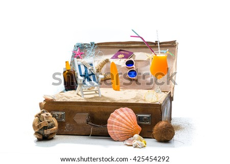 Full open suitcase travel concept  isolated on white selective focus - stock photo
