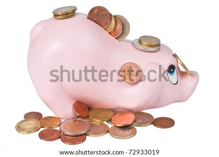 Full piggy coin bank with coins around isolated on white - stock photo
