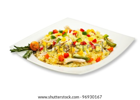 Full plateau with chicken rice and vegetables decorated with rosemary leaves - stock photo