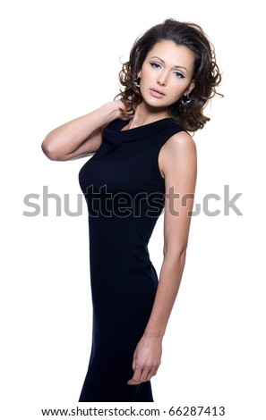 Full portrait of a beautiful adult sensuality woman in black dress posing over white background - stock photo