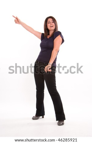 Full portrait of a happy Latin brunette pointing upwards