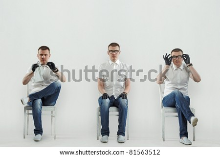 Full portrait of serious handsome man sitting on the chair, isolated on white - stock photo